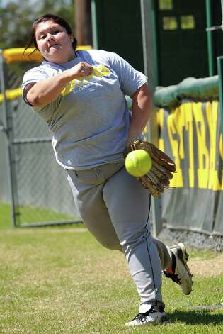 Pitcher Raven Cole throws pitches in the bull pen. The Little Cypress-Mauriceville softball team is currently  ranked sixth in class 4A. In recent years, they have been one of the best teams in Southeast Texas and are currently leading the district. They were out practicing Thursday afternoon March 14, 2013 getting prepared for their Friday match up with Lumberton High School. Dave Ryan/The Enterprise