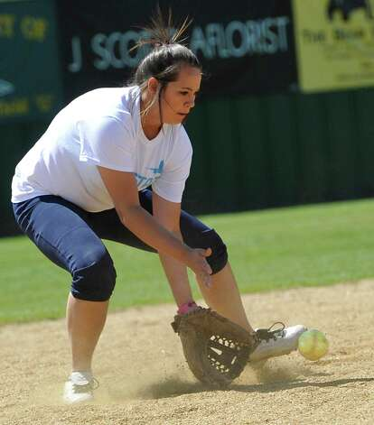 Third baseman Kassie James, tries to trap a hit ball by her coach Dena Adkins who was batting from home plate. The Little Cypress-Mauriceville softball team is currently  ranked sixth in class 4A. In recent years, they have been one of the best teams in Southeast Texas and are currently leading the district. They were out practicing Thursday afternoon March 14, 2013 getting prepared for their Friday match up with Lumberton High School. Dave Ryan/The Enterprise Photo: Dave Ryan