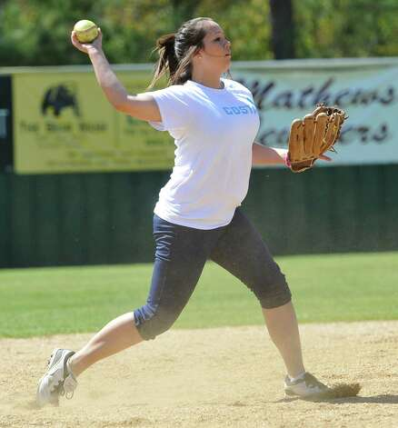 Third baseman Kassie James, throws the ball to first base after catching the ball hit ball by her coach Dena Adkins who was batting from home plate. The Little Cypress-Mauriceville softball team is currently  ranked sixth in class 4A. In recent years, they have been one of the best teams in Southeast Texas and are currently leading the district. They were out practicing Thursday afternoon March 14, 2013 getting prepared for their Friday match up with Lumberton High School. Dave Ryan/The Enterprise