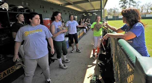 Head Coach Dena Adkins, right, talks to her players during a water break.  The Little Cypress-Mauriceville softball team is currently  ranked sixth in class 4A. In recent years, they have been one of the best teams in Southeast Texas and are currently leading the district. They were out practicing Thursday afternoon March 14, 2013 getting prepared for their Friday match up with Lumberton High School. Dave Ryan/The Enterprise