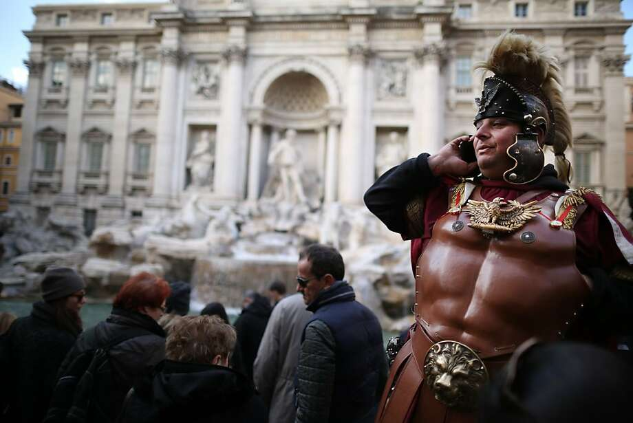 Look, I've got to go -can't afford the Roman charges. (Trevi Fountain, the Eternal City.) Photo: Peter Macdiarmid, Getty Images
