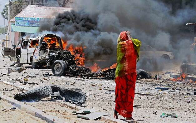 Anguish at the carnage: A Somali woman reacts to the scene of destruction following a car bomb explosion in central Mogadishu. At least eight people were killed in one of the bloodiest attacks in the war-ravaged capital in recent months. Photo: Mohamed Abdiwahab, AFP/Getty Images