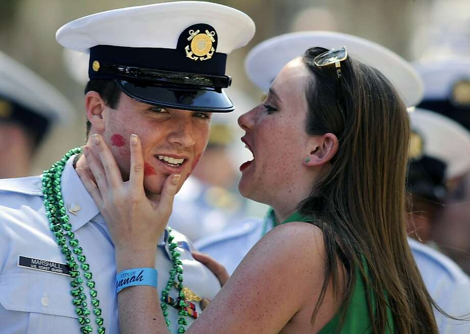 The Coast Guard lets down its defenses during the St. Patrick's Day parade in Savannah, Ga. Petty Officer 3rd Class Tanner Marshall maintained his cool under fire despite several direct hits on the cheeks. Photo: Stephen Morton, Associated Press