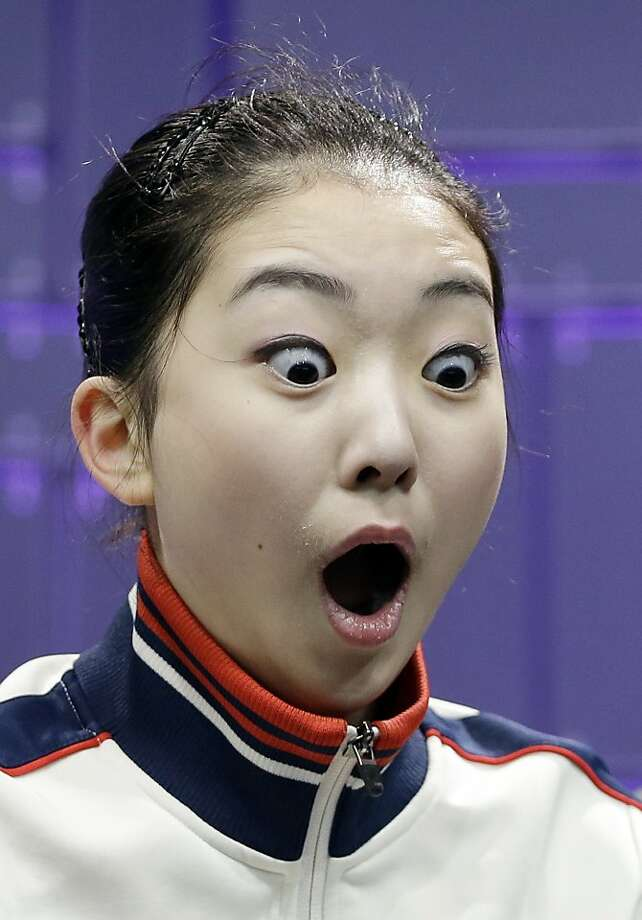 Goodness gracious! Li Zijun watches her scores come up during the free skate program at the World Figure Skating Championships. Apparently she was expecting to do much worse. Photo: Darron Cummings, Associated Press