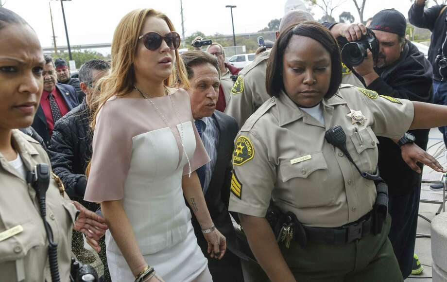 Actress Lindsay Lohan arrives at the Los Angeles Superior court Monday before agreeing to a plea agreement. Photo: Damian Dovarganes / Associated Press