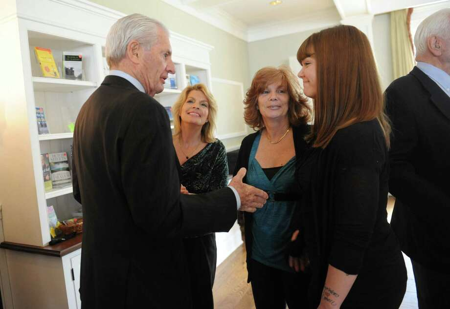 From left, Lance Minor spoke to the daughters of Briggs Baugh, Anne Minnehan, Betsy Necatera, and her daughter Stephanie Necatera, 26, at a memorial service for Briggs Baugh at the Stanwich Congregational Church, in Greenwich, Conn., Monday, March 18, 2013. Baugh, 85, died of cancer March 7 at Paradigm Healthcare Center in Norwalk. Not only was Baugh the town's first recycling coordinator, a position created in the Department of Public Works, but he spearheaded a joint volunteer effort to collect cans and paper goods with Greenwich High School in observance of Earth Day. Photo: Helen Neafsey / Greenwich Time