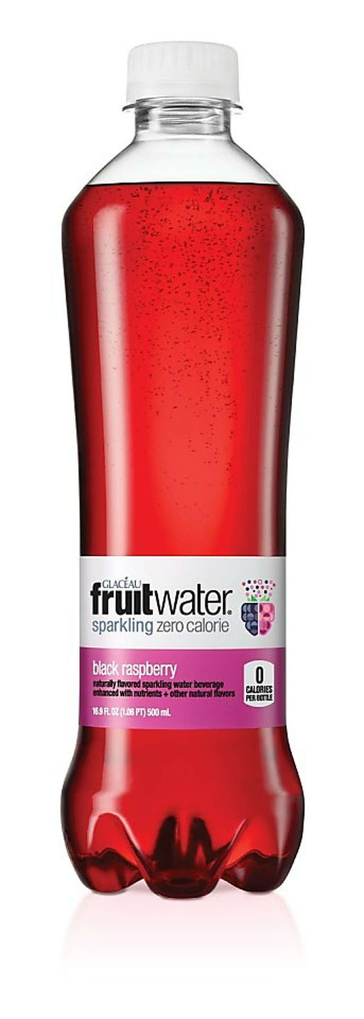 This product image provided by Coca-Cola shows a bottle of black raspberry flavored Fruitwater. Coca-Cola is introducing a line of fruit-flavored seltzer waters called Fruitwater on April 1. The drink is part of the company's Glaceau unit, which also makes Smartwater and Vitaminwater. (AP Photo/Coca-Cola)