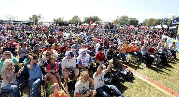 Spectators watch and cheer as anglers make the stage for weigh in on the second day of the 2013 Bassmasters Elite Series Sabine River Challenge. Photo taken: Randy Edwards/The Enterprise