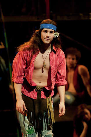 "Staples High School graduate Adam Kaplan is less than a year out of college and has landed dual roles in the Broadway hit ""Newsies."" Here he is seen in a college production of ""Hair."" Photo: Contributed Photo"