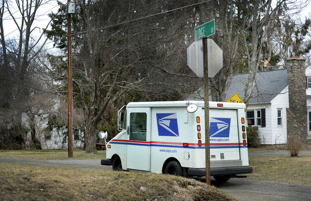 A U.S. Postal truck heads down Ridge Road in Danbury, Conn. Monday, March 18, 2013. Photo: Carol Kaliff / The News-Times