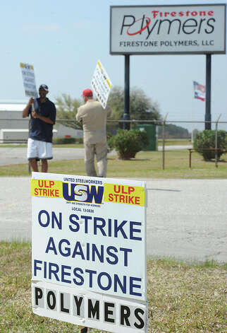 Members of Local No. 13-836 of the United Steelworkers union began striking Monday at Firestone Polymers in Orange after negotiations failed to resolve issues that included a wage increase and health insurance deductibles. The union has 108 members who will work in four-member shifts with two members picketing at a time. About 20 nonunion hourly workers are affected by the strike, but won't be picketing, a union official said. Gary Brinson, right, and Marvin Davis picket the front gate of Firestone Polymers in the strike that began noon Monday.    Photo taken Monday, March 18, 2013 Guiseppe Barranco/The Enterprise Photo: Guiseppe Barranco, STAFF PHOTOGRAPHER / The Beaumont Enterprise