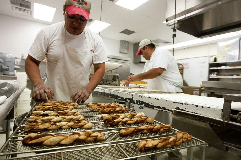 Carlos Fuentes prepares cinnamon twist at the Shipley's Do-Nuts on Wednesday, March 13, 2013, in Houston.   Photo: J. Patric Schneider, Freelance / © 2013 Houston Chronicle