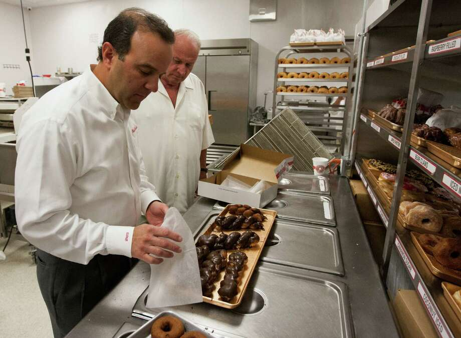 Lawrence Shipley III, front, and general manager Kirk Holt  prepares cinnamon twist at the Shipley's Do-Nuts on Wednesday, March 13, 2013, in Houston.   Photo: J. Patric Schneider, Freelance / © 2013 Houston Chronicle