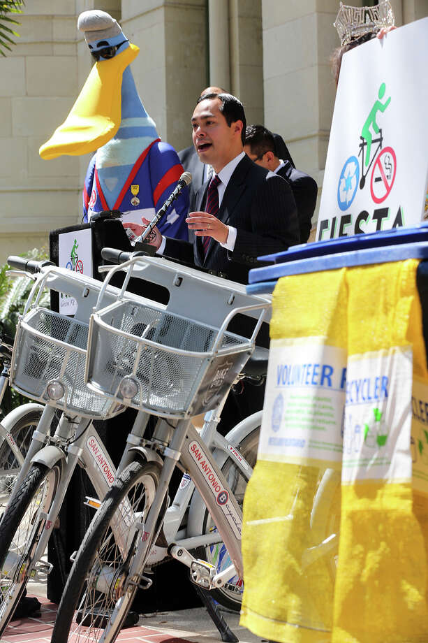During a press conference in front of City Hall on Monday, March 18, 2013, San Antonio Mayor Julian Castro encourages Fiesta attendee to make healthier food choices, recycle and used the B-Cycle program during the 11-day event. Fiesta 2013 officially kicks off on April 18. Photo: JERRY LARA, San Antonio Express-News / © 2013 San Antonio Express-News