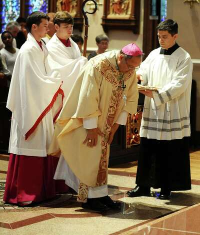 Area catholics gather at Saint Anthony Cathedral Basilica on the evening of Wednesday, March 13, 2013, to celebrate with Bishop Curtis Guillory.  Pope Francis I, formerly Cardinal Jorge Bergoglio of Argentina, was announced the new leader of the Roman Catholic church. Photo taken: Randy Edwards/The Enterprise