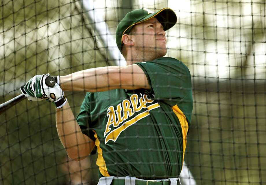 Oakland Athletics' Out Fielder, Todd Linden, follows the flight of his ball during batting practice at Papago Park in Phoenix, Ariz. on Thursday, Feb. 21, 2008. Photo By Lance Iversen / San Francisco Chronicle Photo: Lance Iversen, SFC