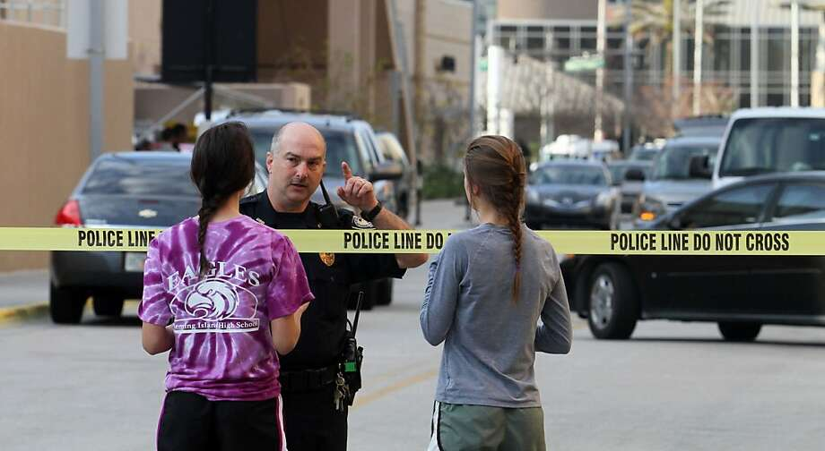 University of Central Florida students talk to a police officer after student James Oliver Seevakumaran apparently committed suicide in his dorm room. Photo: Red Huber, McClatchy-Tribune News Service