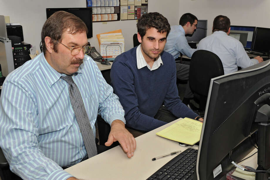 From left, CIS mentor Charlie DeVoe teaches Philippe Langlois, teaching hospital resident,  in the forensics analysis lab at the Center for Internet Security on Wednesday Feb. 27, 2013 in East Greenbush, N.Y. (Lori Van Buren / Times Union) Photo: Lori Van Buren