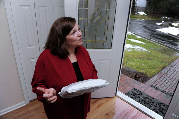 Arlene Rice, of Danbury, Conn., holds a package that has just arrived at her front door. After having repeated difficulty receiving mail, Rice spearheaded an effort to get the name of her road changed to Red Ridge Road. Photo: Carol Kaliff / The News-Times