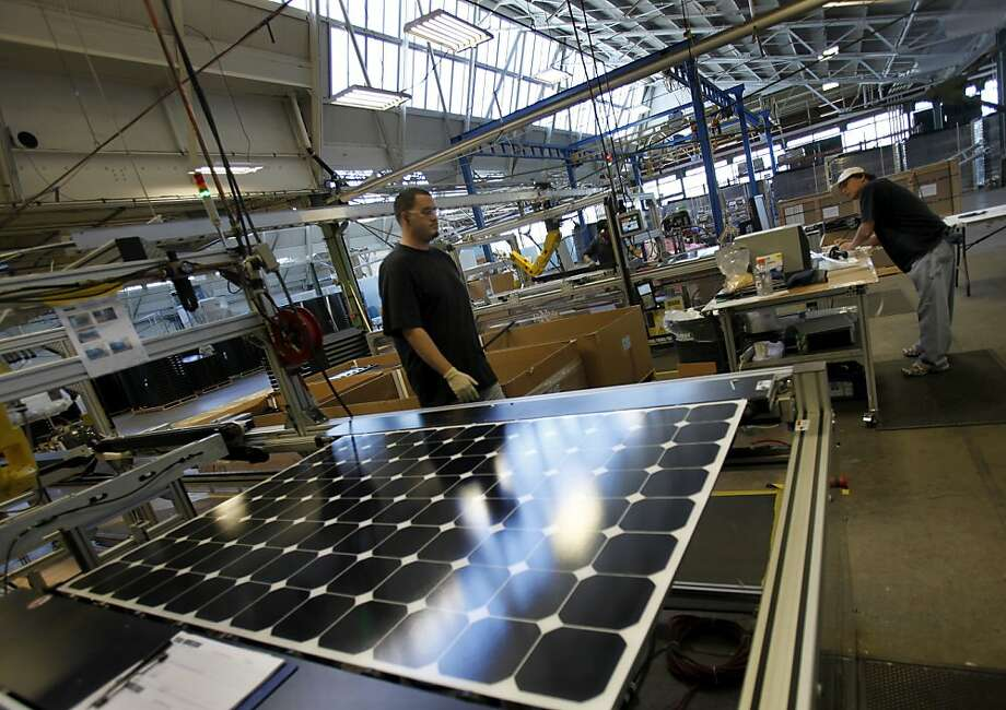 SunPower, which does a lot of its manufacturing at plants like this one in Richmond, is selling two large solar plants to Warren Buffett's MidAmerican Energy Holdings Co. Photo: Brant Ward, The Chronicle