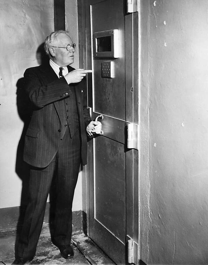 Alcatraz warden James Johnston points to the door of the main cell block which kept rioting prisoners from escaping because a guard, held by the rioters, threw away the key.  The riot ended on May 4, 1946. Photo: Associated Press