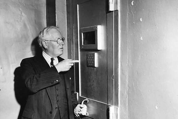Alcatraz warden James Johnston points to the door of the main cell block which kept rioting prisioners from escaping because a guard, held by the rioters, threw away the key.  The riot ended on May 4, 1946.