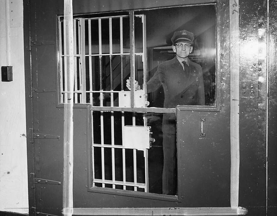 Double doors seal the entrance to the main cell house from the dining room at Alcatraz in this photo from March 14, 1956. First there is a big door of steel with glass panels, then a sliding door of steel bars. Photo: Joe Rosenthal