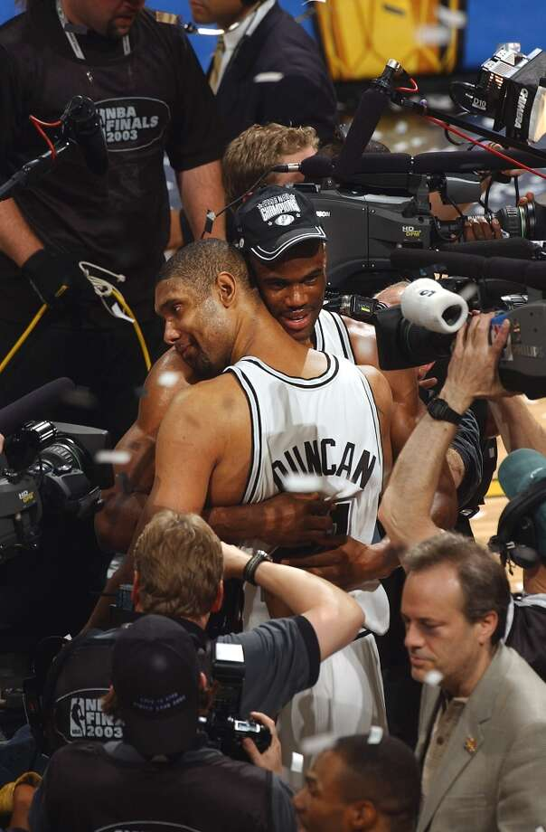 The Spurs' Tim Duncan and David Robinson hug during the celebration after winning the NBA Championship at the SBC Center on June 15, 2003. Photo: WILLIAM LUTHER, SAN ANTONIO EXPRESS-NEWS / SAN ANTONIO EXPRESS-NEWS
