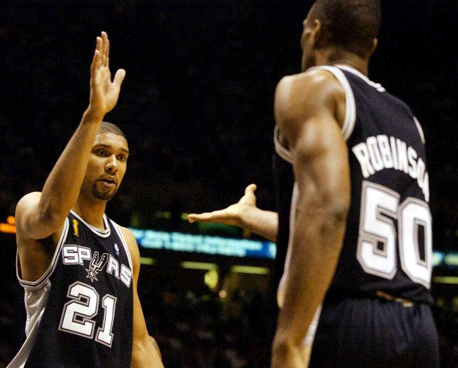 The Spurs' Tim Duncan (left) and David Robinson congratulate each other in Game 5 of the NBA Finals at Continental Airlines Arena in New Jersey on June 13, 2003. Photo: JERRY LARA, SAN ANTONIO EXPRESS-NEWS / SAN ANTONIO EXPRESS-NEWS