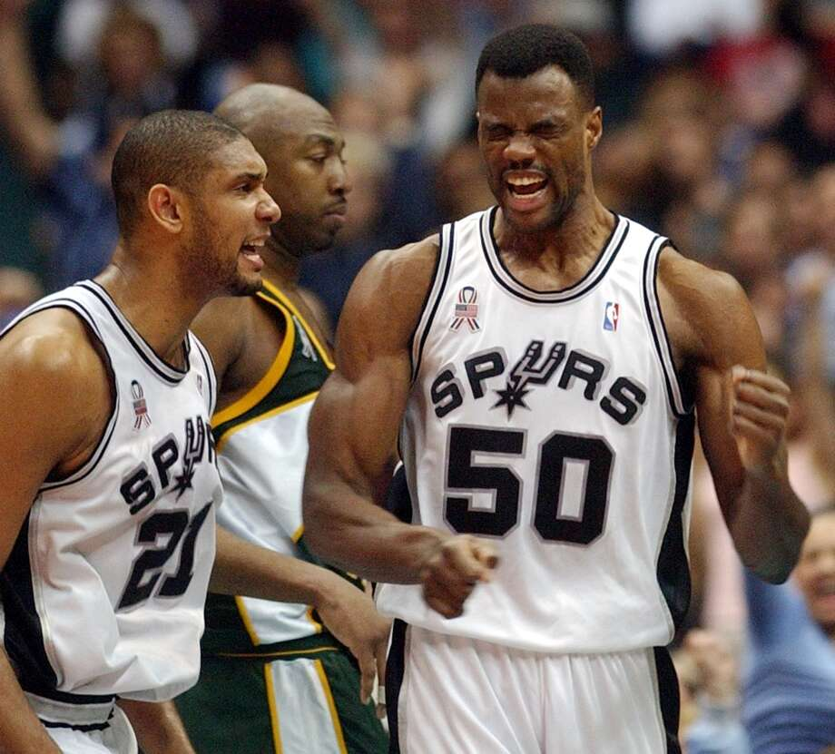 The Spurs' David Robinson (right) and Tim Duncan celebrated April 3, 2002 in the Alamodome after Robinson scored two of his 20 points during the Spurs' 90-88 win over the Seattle Supersonics. Photo: WILLIAM LUTHER, SAN ANTONIO EXPRESS-NEWS / SAN ANTONIO EXPRESS-NEWS