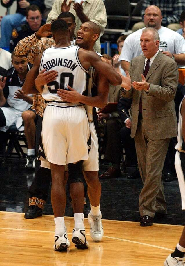 The Spurs' David Robinson is congratulated March 5, 2002 by teammate Tim Duncan as Robinson leaves the game after scoring his 20,000th and 20,001st career points. Robinson was the 27th player in NBA history to break the 20,000 point barrier. Photo: WILLIAM LUTHER, SAN ANTONIO EXPRESS-NEWS / SAN ANTONIO EXPRESS-NEWS