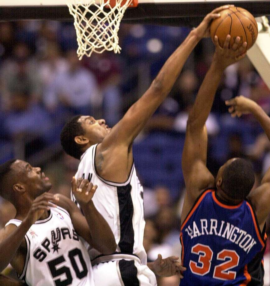 Tim Duncan blocks the shot of Othella Harrington in the first half Oct. 19, 2001 at the Alamodome as David Robinson provides support. Photo: BAHRAM MARK SOBHANI, SAN ANTONIO EXPRESS-NEWS