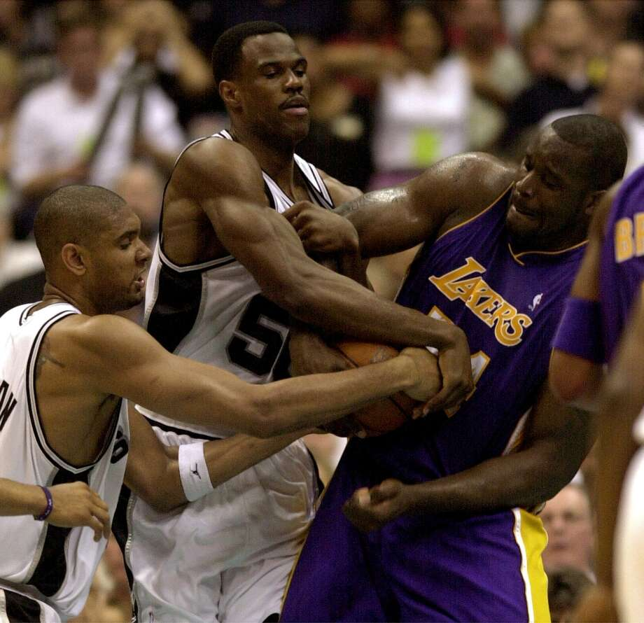 The Spurs' Tim Duncan and David Robinson struggle with the Lakers' Shaquille O'Neal for control of the ball during fourth quarter action at the Alamodome on Saturday, May 19, 2001 in the Western Conference playoffs. Photo: KIN MAN HUI, SAN ANTONIO EXPRESS-NEWS / SAN ANTONIO EXPRESS-NEWS