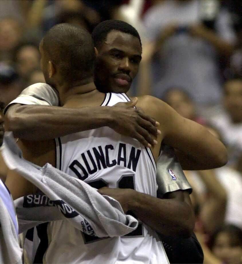 David Robinson hugs teammate Tim Duncan during the closing moments of the game at the Alamodome in San Antonio May 14, 2001 during the Western Conference playoffs. Photo: DELCIA LOPEZ, SAN ANTONIO EXPRESS-NEWS / SAN ANTONIO EXPRESS-NEWS