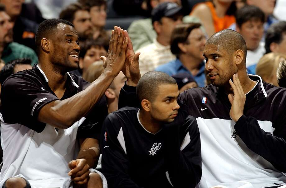 The Spurs' David Robinson (left) and Tim Duncan high five over Tony Parker during Game 2 of the Western Conference semifinals at the SBC Center on May 7, 2003. Photo: WILLIAM LUTHER, SAN ANTONIO EXPRESS-NEWS / SAN ANTONIO EXPRESS-NEWS