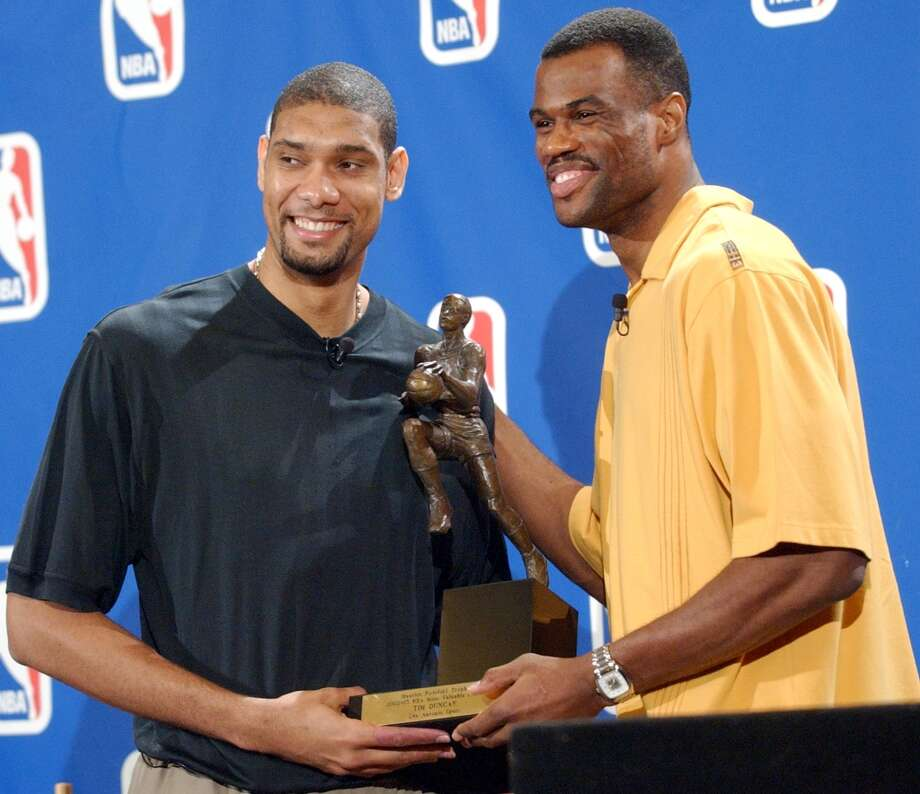 Tim Duncan is all smiles as he is presented the Maurice Podoloff Trophy, by teammate David Robinson after being named the NBA's most valuable player S May 4, 2003. Photo: EDWARD A. ORNELAS, SAN ANTONIO EXPRESS-NEWS / SAN ANTONIO EXPRESS-NEWS