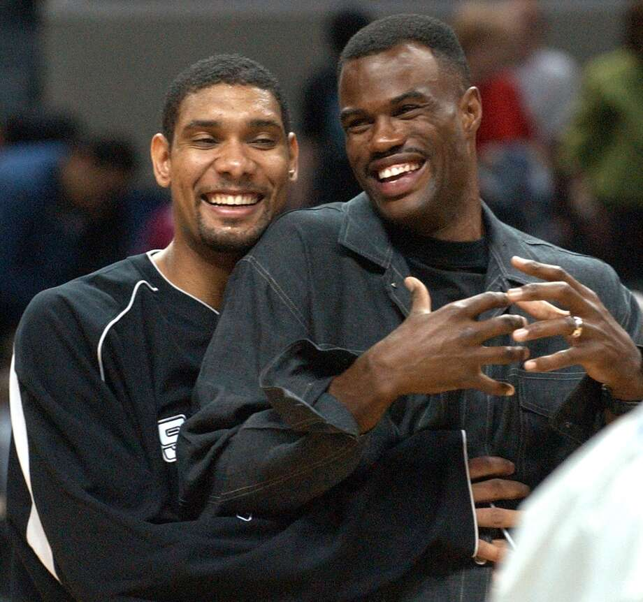 The Spurs' Tim Duncan jokes with former teammate David Robinson prior to accepting the David Robinson Plaque before the game with the Sixers Thursday Oct. 21, 2004 at the SBC Center. Photo: EDWARD A. ORNELAS, SAN ANTONIO EXPRESS-NEWS / SAN ANTONIO EXPRESS-NEWS