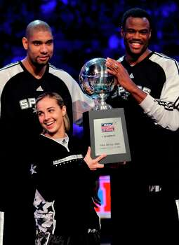 The Silver Stars' Becky Hammon holds the trophy with the Spurs' Tim Duncan (left) and former Spurs player David Robinson after they won the shooting stars competition Feb. 16, 2008, at the NBA All Star Weekend in New Orleans. Photo: Eric Gay, AP / AP
