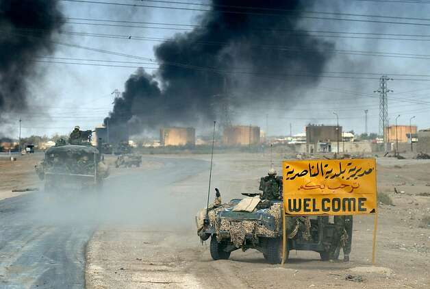US Marines from the 2nd Battalion 8th regiment enter in the southern Iraqi city of Nasiriyah, where allied troops found stuborn resistance in their northbound advance torwards the Iraqi capital Baghdad 23 March 2003. Photo: Eric Feferberg, AFP/Getty Images