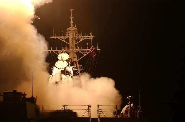 Tomahawk Land Attack Missiles (TLAM) launch from the ship's forward and aft MK-41 vertical launch systems (VLS) aboard the guided missile destroyer USS Donald Cook March 20, 2003 in the Red Sea. The cruise missiles were among the first to be fired in support of Operation Iraq Freedom.  Photo: U.S. Navy, Getty Images
