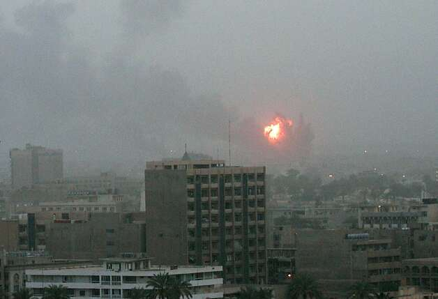 "An explosion is seen in Baghdad 20 March, 2003, as the US launched a war on Iraq with air strikes on the capital, making good on threats of military action to push President Saddam Hussein out of power. US President George W. Bush announced 19 March he had launched war against Iraq. ""My fellow citizens, at this hour American and coalition forces are in the early stages of military operations to disarm Iraq, to free its people and to defend the world from grave danger,"" Bush said.  Photo: Patrick Baz, AFP/Getty Images"