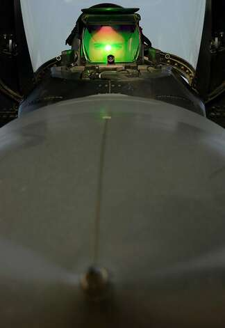 "U.S. Air Force pilot ""Split"" from Williamsburg, Virginia looks through a ""heads up"" display from inside an F-16 fighter jet after his mission into Iraq March 28, 2003 at an air base in Kuwait, as Operation Iraqi Freedom continues with a strategic air campaign. Photo: Paula Bronstein, Getty Images"