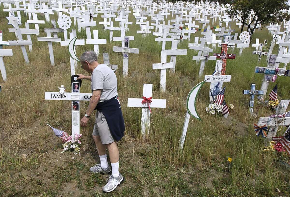 Bob Hanson visits the memorial of white crosses on a hillside in Lafayette, Calif. on Friday, March 15, 2013, that he regularly maintains. Anti-war activists erected the monument in late 2006 as a tribute to soldiers who died in the Iraq and Afghanistan wars. Tuesday marks the 10th anniversary of the war in Iraq.