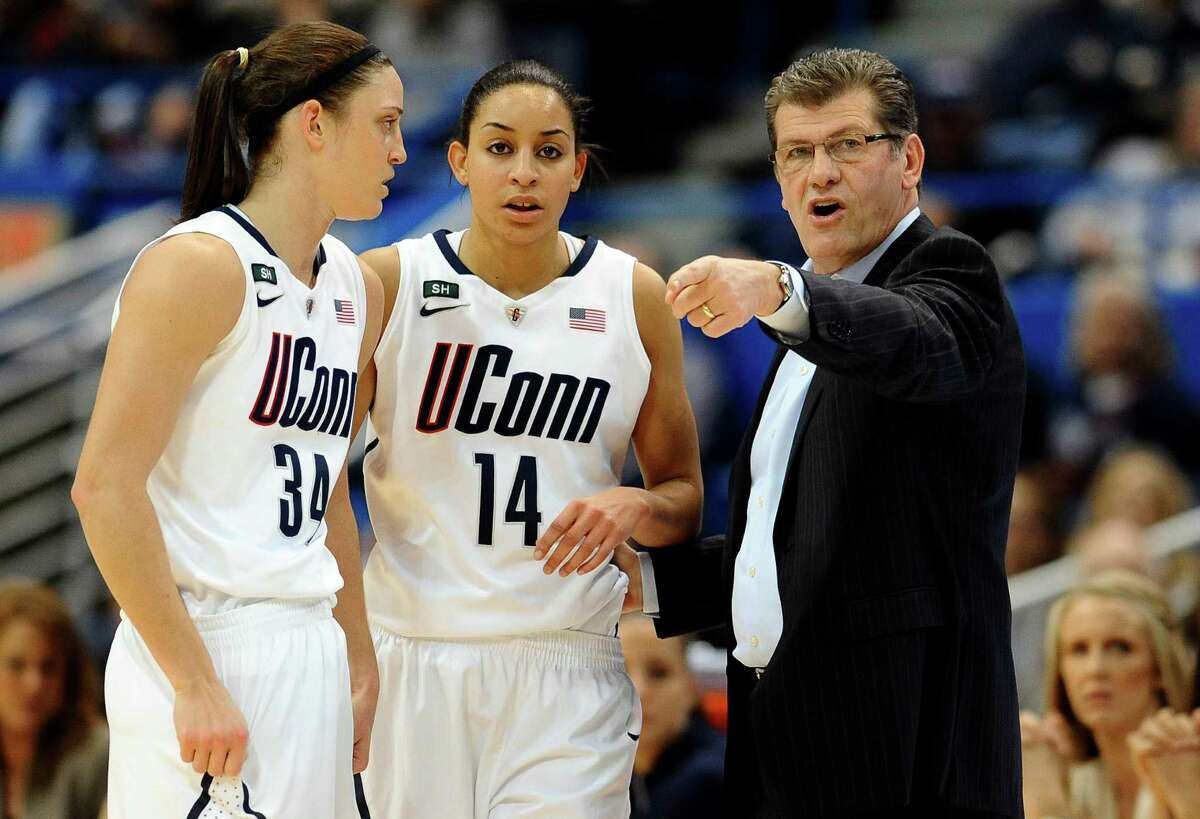 FILE - In this March 11, 2013, file photo, Connecticut head coach Geno Auriemma, right, talks with Kelly Faris (34) and Bria Hartley (14) in the first half of an NCAA college basketball game against Syracuse in the semifinals of the Big East Conference tournament in Hartford, Conn. Connecticut was announced Monday, March 18, to join Baylor, Stanford and Notre Dame as a No. 1 seed in the women's tournament, marking the second straight season those four schools were the top seeds. (AP Photo/Jessica Hill, File)
