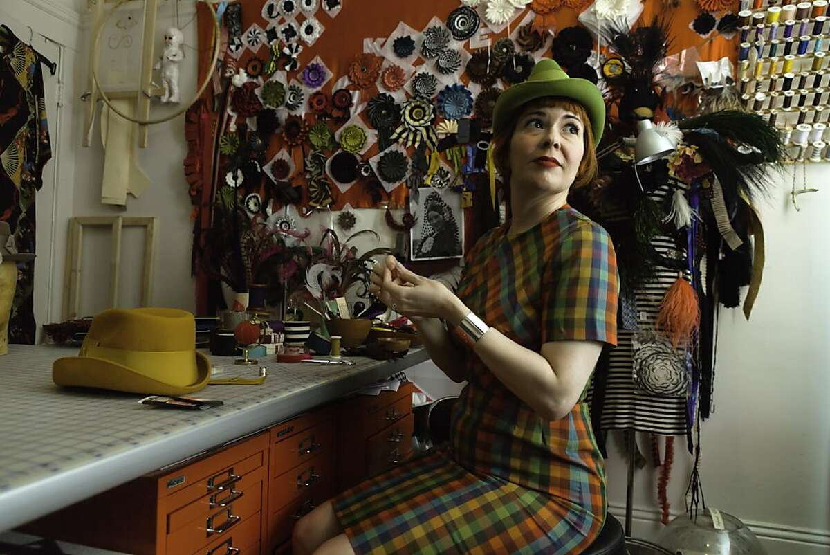 Tricia Roush applies a ribbon to her Drake hat in her studio in San Francisco, CA on Sunday, March, 17 2013.