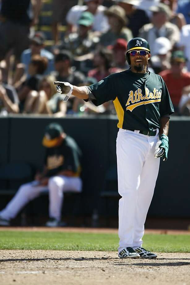 Center fielder Coco Crisp shows the way for his younger teammates on the Oakland A's. Photo: Pete Kiehart, The Chronicle