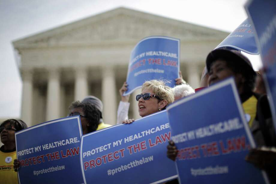 Backers of health care reform hold a rally at the Supreme Court in March 2012. Enrollment under the Affordable Care Act will start Oct. 1. Photo: Associated Press File Photo