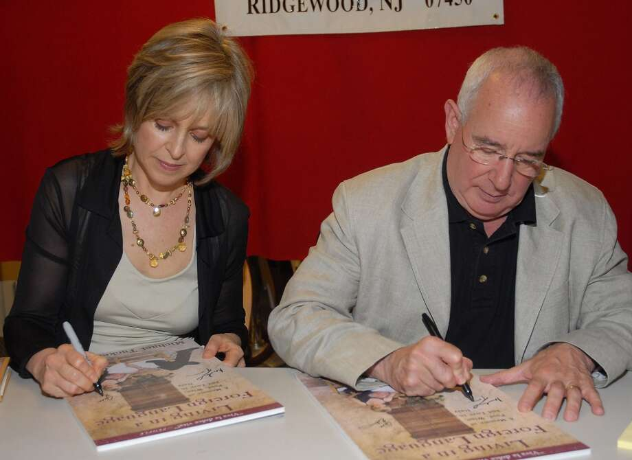 Here the two sign copies of the book Living in a Foreign Language: A Memoir of Food, Wine, and Love in Italy in 2007. Tucker wrote the book ... though one suspects he had input from Eikenberry. (Photo by Bobby Bank/WireImage)