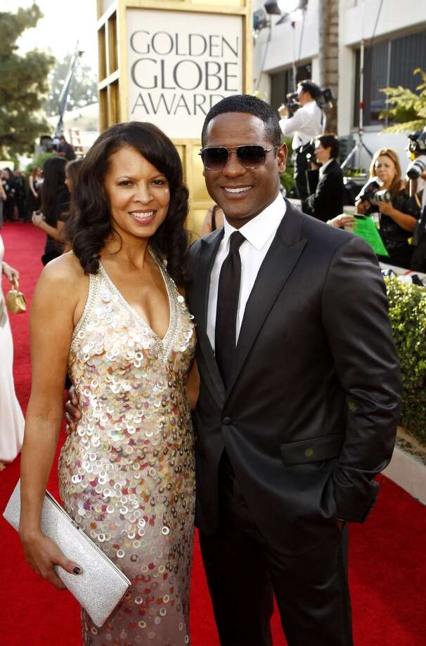 Here he arrives with his wife Desiree Underwood at the 68th Annual Golden Globe Awards in 2011.