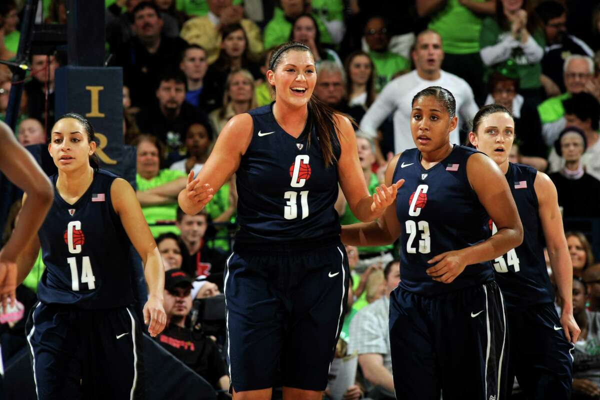 Connecticut forward Stefanie Dolson, middle, reacts to a foul call as teammates Bria Hartley left, and -Kaleena Mosqueda-Lewis, middle right, and Kelly Faris, far right, look on during action in a college basketball game Monday March 4, 2013 in South Bend, Ind. (AP Photo/Joe Raymond)
